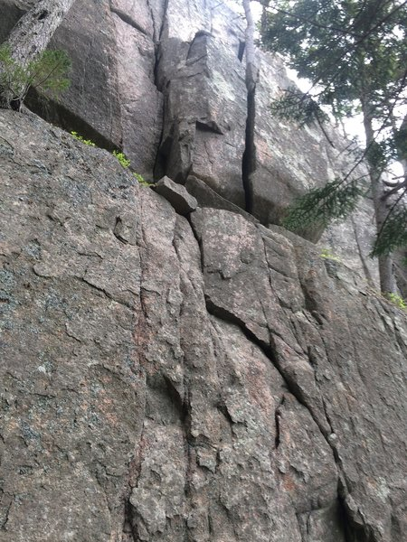 Alley Ouff is the off width crack on the right. Ragged Edges is the crack to the left. A bolt protected face below leads to either of these two routes.