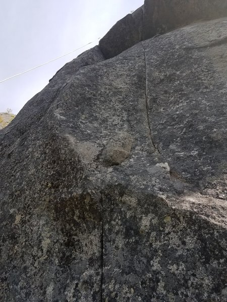 Crux seam at the base of the route
