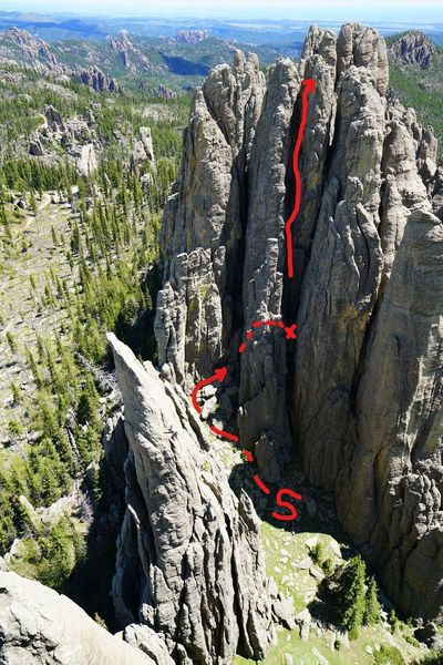 The route we took.  Walk up to where the first arrow ends (the S is for Start, which I realize in retrospect is stupid and confusing) and do short up and over chimney to get to the chockstone ledge.  Up from there for 2nd pitch.  .