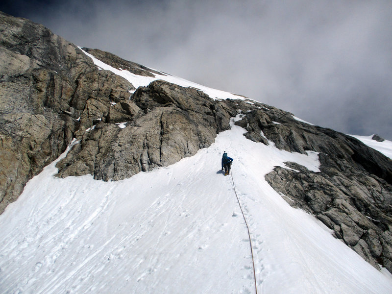 John leading out of the col over the cl. 3 slabs to access the summit snowfield.