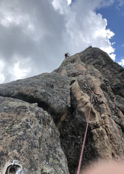 Gramps nearing the top of P2. Look for this type of wavy rock around the 1st-3rd bolt of P2 (if using a 60m) to help find this route and not accidentally hop on the others nearby.
