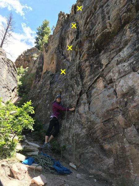 """""""Fun For The Whole Family"""" location photo. Rope is hanging from the anchor and Mandy is directly under the bolt line."""