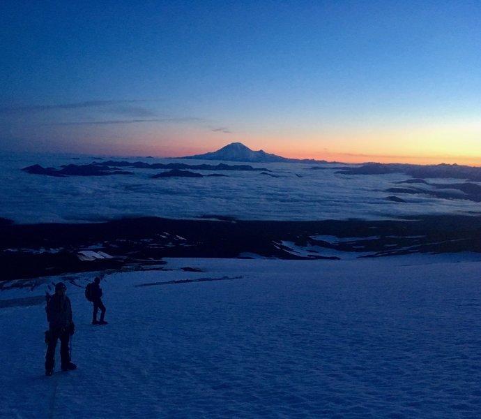 Alpine start June 2019 looking back at Mt. Rainier and the lower Adams Glacier