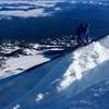 On belay crossing a snow bridge half-way up the Adams Glacier