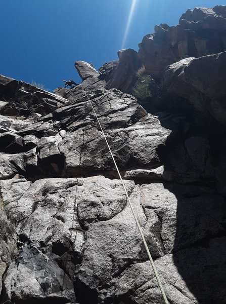 Climb the rope line for a 5.10 face or right for a 5.8 corner.