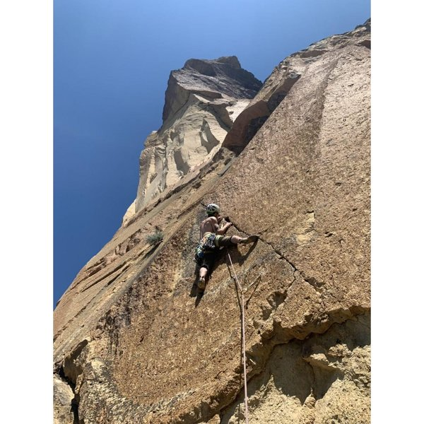 Crux is getting established on the slab on sharp finger locks. 35 feet of fingers into perfect hands