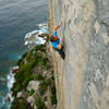 Jake Noblett climbing The Sublime and the Ridiculous (26/7b ) at Windjammer Wall, Point Perpendicular