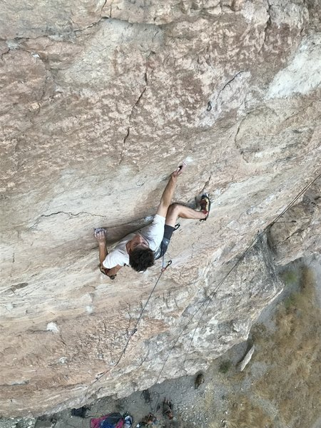 """Hunter Murray pulls past the middle crux on the second ascent of """"Push Me,Pull Me""""."""