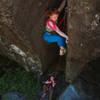 Anabel thrutching her way up White Zombie with Alec on belay.