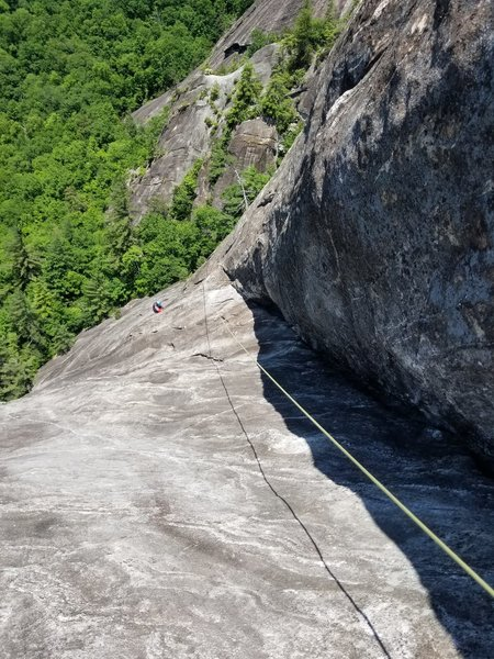 Go as high as you can before the down climb/traverse pitch