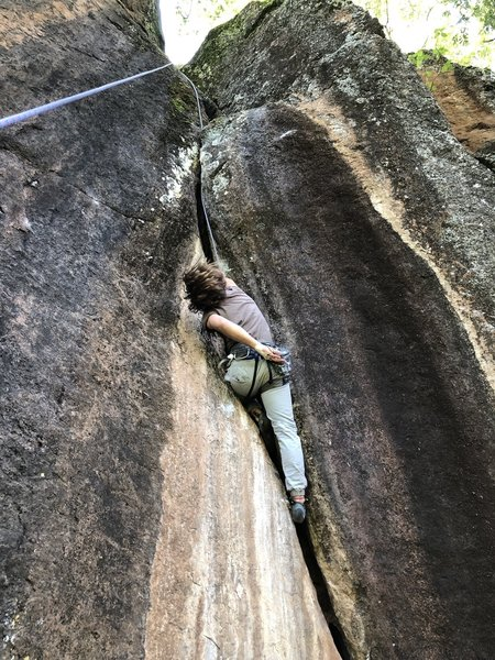 Approaching the crux and overhanging layback. Pump city!