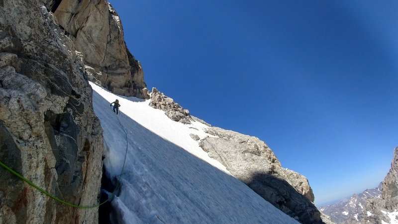 Heading across the snowfield on the first ledge.