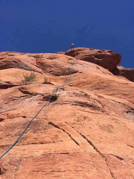 Starting the rap from the summit. You definitely need a 70m rope.