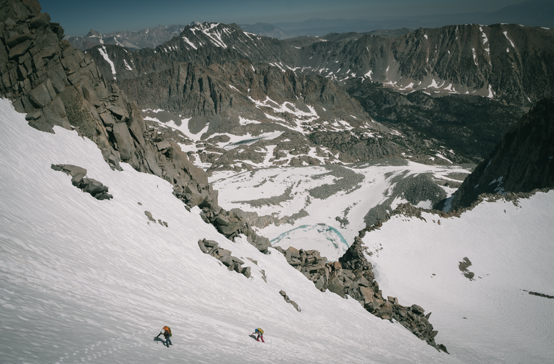Two climbers headed up the L shaped couloir on the way to the base of Swiss Arete
