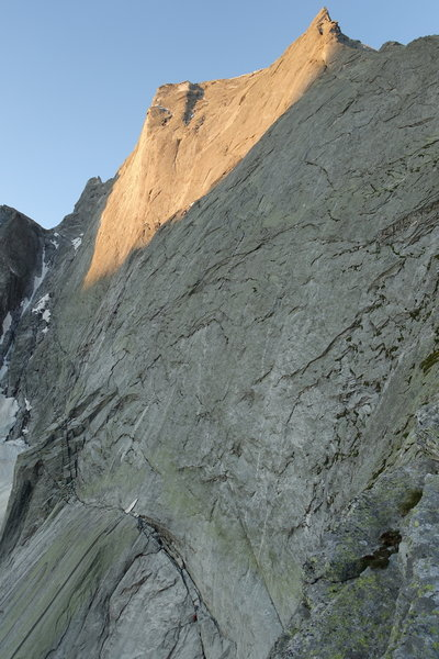 Climbers can be seen on the scramble to the beginning of the huge Cassin face, at the bottom of the picture.