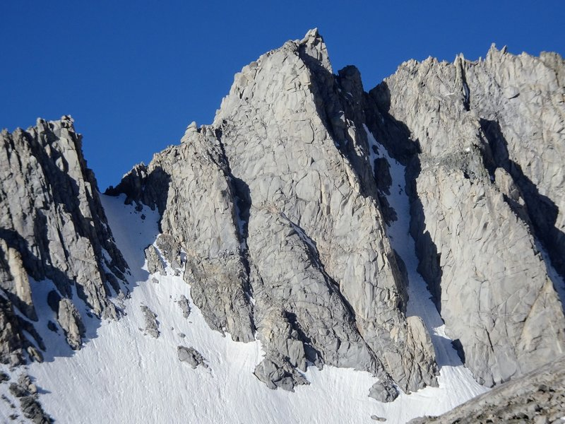 East Spire (center) and West Spire (pointy little block on right). North Arete ascends the central rock buttress, and the North Couloir is the obvious shaded gully just to the right.