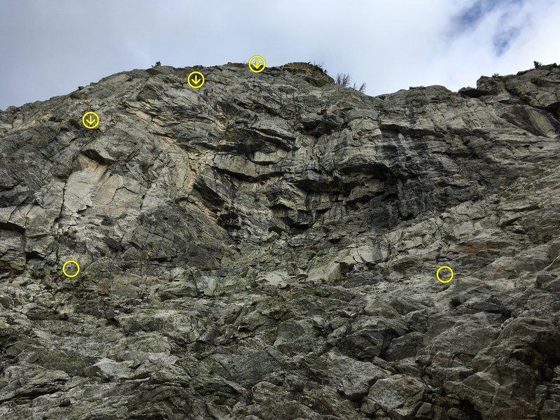 Reticent Wall start and rappels (approximate) on the left, Incognito Buttress start on the right