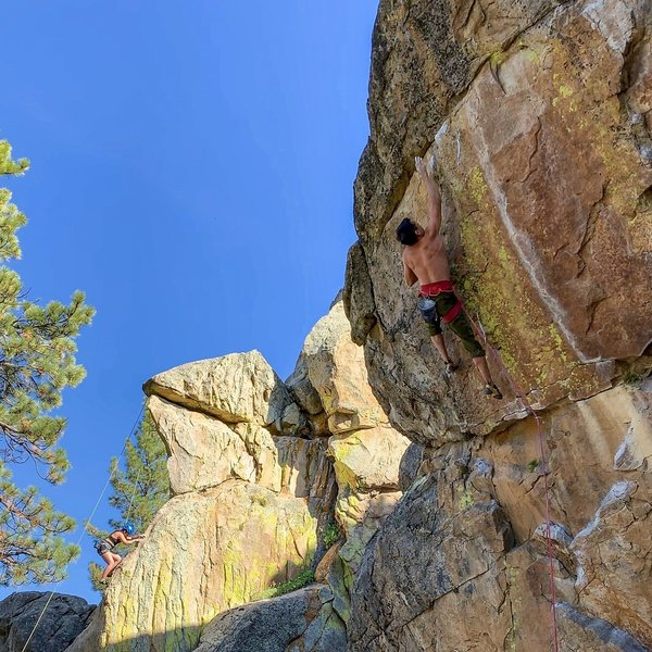Cliff T making the last move of the crux.