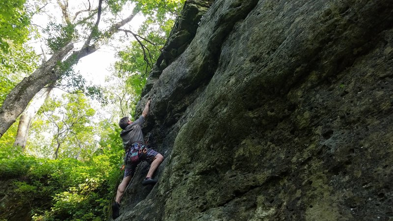 Jim making his way up to the second bolt on the Mad Corner