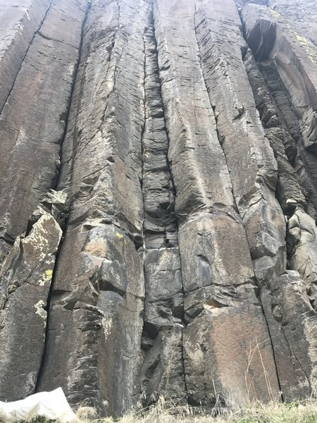 Several routes pictured. column to left of central twin cracks is a 3 star 5.9. 3rd or 4th bolt hangar missing. Thin pro can be placed for extra comfort