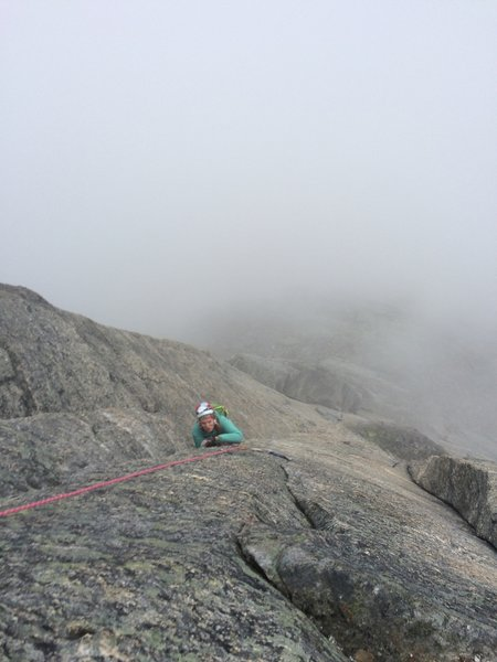 Kat, climbing out of the clouds and drizzle on the steep upper part of the mountain.