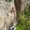Jake Noblett climbing High Roller (25/7b) at the Gold Mine