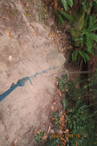 use the rope to climb the slope on the way up