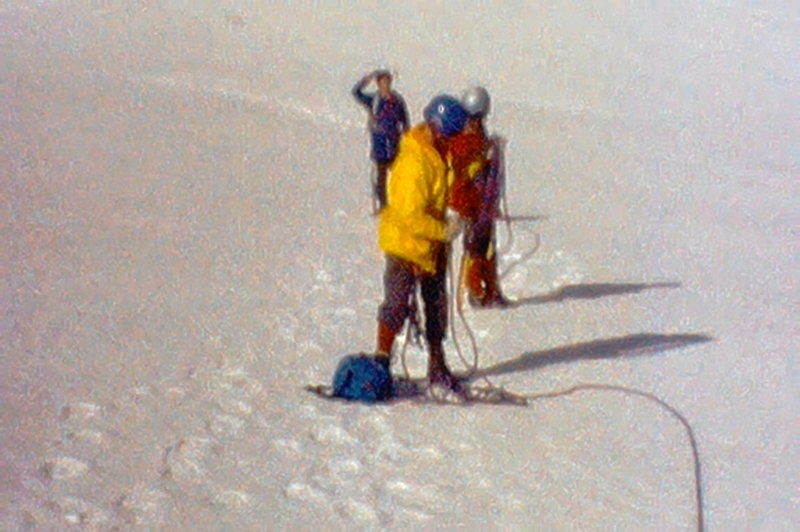 """Photo 5 - On the flat section of the glacier.  When we reached it it had not yet had sun and was """"bullet hard"""" so we put on crampons.  (from Super 8 film)"""
