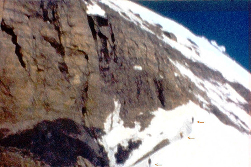 "Photo 3 - Three of our party approach the SE Arete/Ridge ""proper"".  My recollection is that it was either just below here, or somewhere in this picture that we hit some ice. Without crampons we chopped steps...slow going. (from super 8 film)"