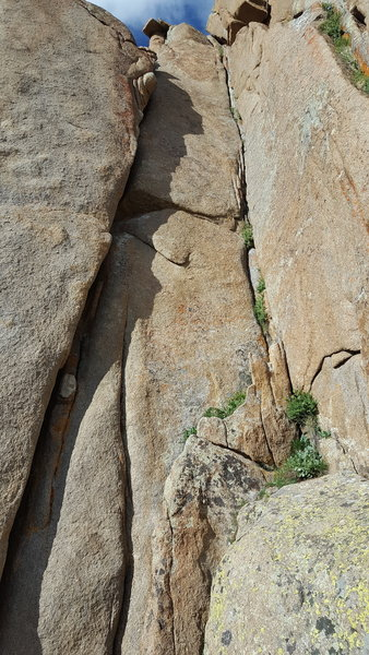 Right side of Instant Karma Cliff: the left hand/fist crack is Kundalini, 5.10c. The right corner crack is Karma Corner, 5.8.