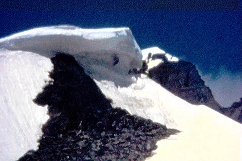 """Photo 4 - Cornice along the SE Ridge (""""Arete"""") of Odaray  Like most obsticals on the ridge, this is circumvented to the left.  (from Super 8 film)"""