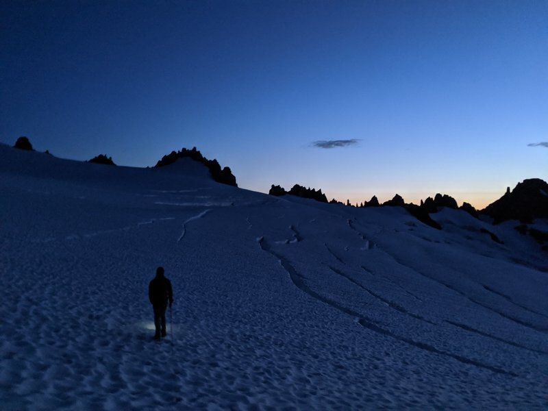 Traversing the Inspiration Glacier at dawn. Tepeh Towers on the horizon. (Photo: Erick T.)