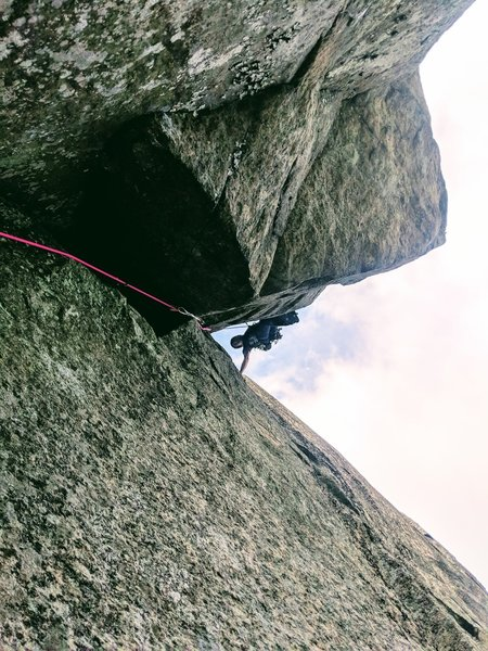 Getting established in the Diheadral after clearing the awkward crux roof at the start of pitch 2
