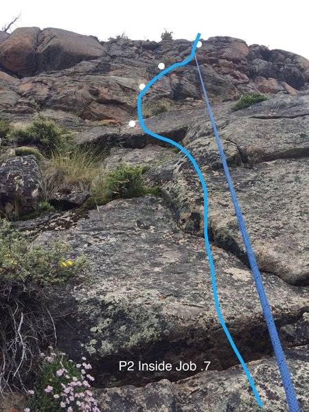 P2 of Inside Job. Note...climb to the right of the grassy gully with good gear and a bolt before the ledge.