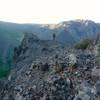 Giselle strides along the summit ridge of the Ordovician Ogopogo on a hazy summer evening.