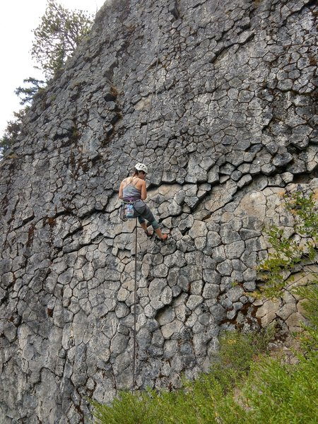 Tara rappelling the route after cleaning the anchor. Vultures is the route immediately to the right.