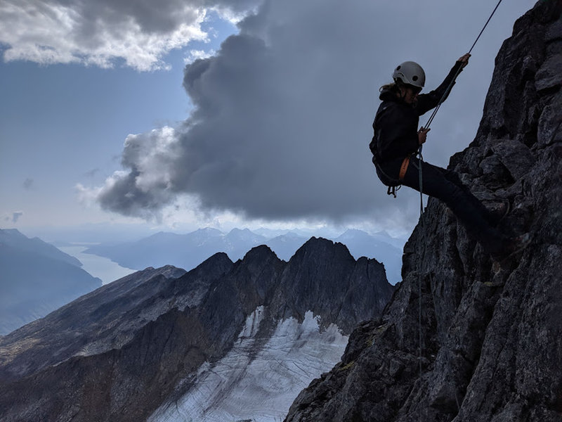 1st Rap of the Summit Spire & Good Views of Lynn Canal. That is South, looking towards Haines, AK. You can make it down to the Base of the climb with a single Rap on a 60m rope. There is a single sling at the top of the Spire.
