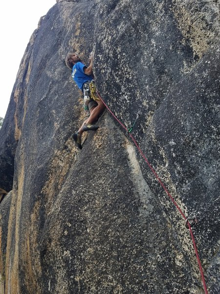 Jerome Weber grapples with the mid section of Sherman Tank, 5.11c/d.