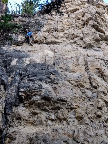 Jerry hucks his way over the roof of I'm Lichen My Adventure Pants, 5.10b. Holy Hanna Crag. Spearfish Canyon. Black Hills of South Dakota.