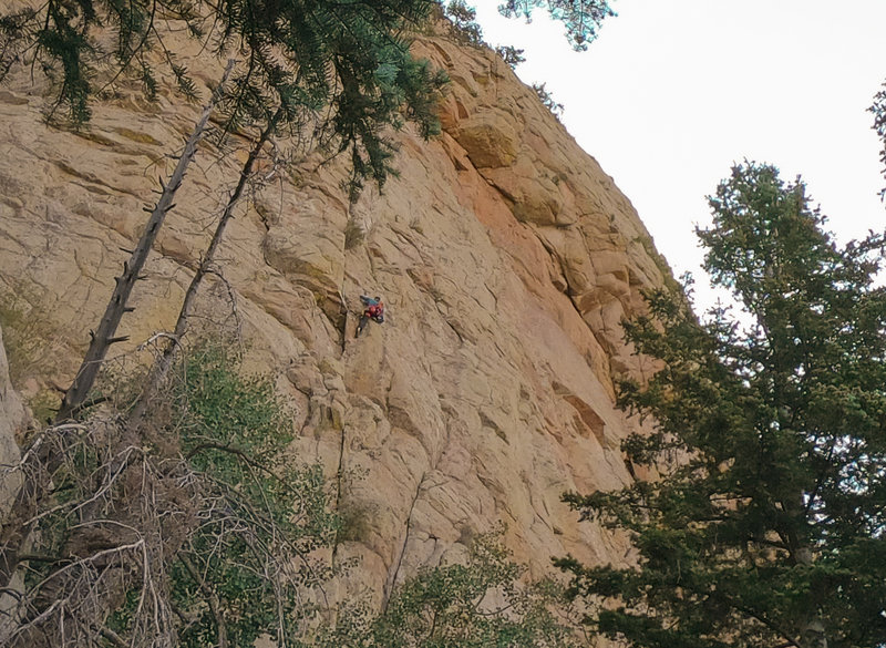 About halfway up P1 of the West Ridge. Escaping this small roof to the right felt like the crux to me.