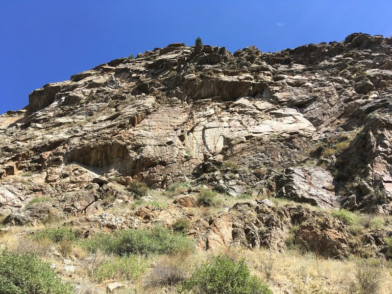A view of the crag from the bike path. The climber in the middle of the photo is on Reincarnation.