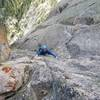 Mariann having fun on the crux pitch of Mountaineer's Route