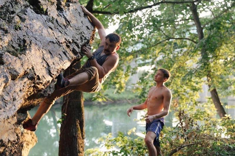 Adam Lopardo climbing with Jonas Smith Watching.