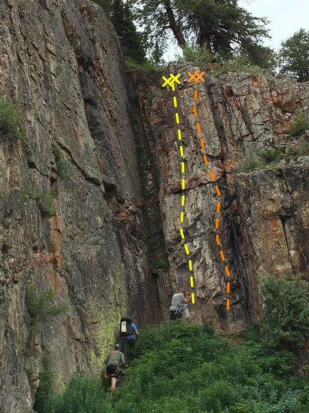The 2 bolted routes are on the back wall. The left face route is harder than the arete on  the right.