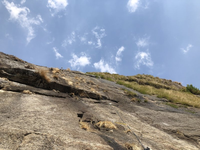 Scott resting on the fourth pitch right before taking a massive clipping fall on a slab bulge during the FA