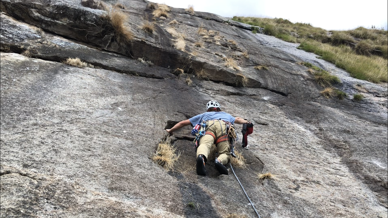Scott adding some bolts on lead during the FA