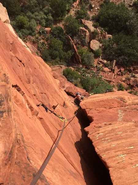 Ian ledge humping his way to P1 anchor. Easy (5.5ish) on this last bit.