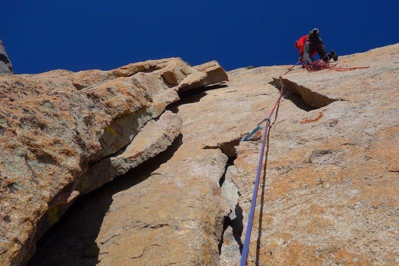 Fun climbing between flakes near top of pitch 3.