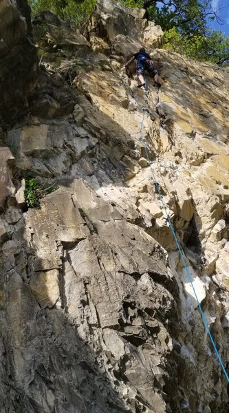 Martin high up on the route (first bolt may not be clipped)