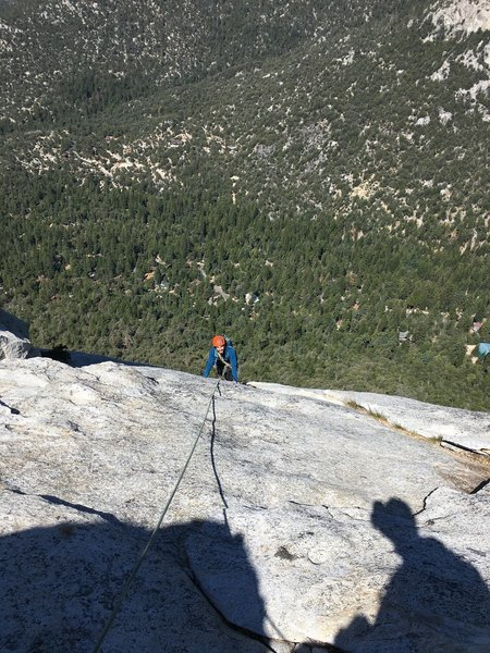 Pitch 4 finish. Easy slab section but a bit runout until you get to the small tree. There is an orange bolt soon after.